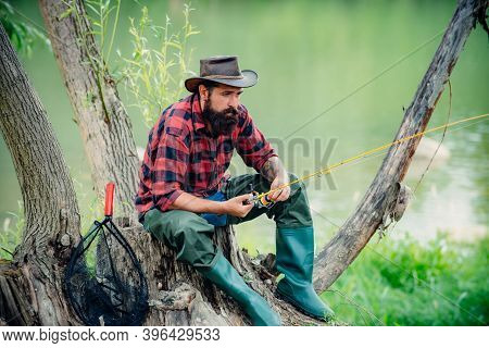 Man Bearded Fisher. Fishing On River. Active Sunny Day. Fishing As Holiday. Activity And Hobby. Havi