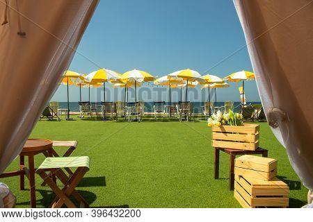 Tropical View Of Beach Chair And Umbrella On Sea Coast And Sand Beach.