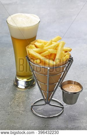 Belgian frites wrapped in paper cone with samourai sauce and beer
