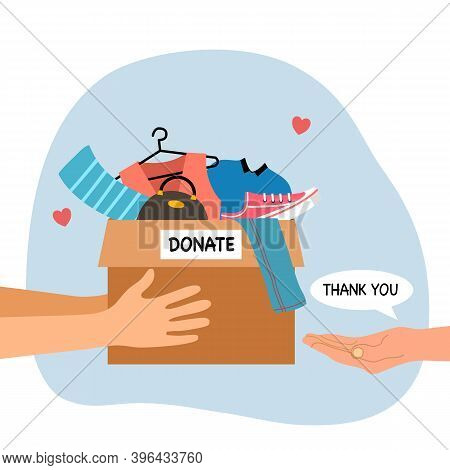 Sharing Clothes To People. Clothes Donation Concept. Woman Hand Holding Box Full Of Clothes And Acce