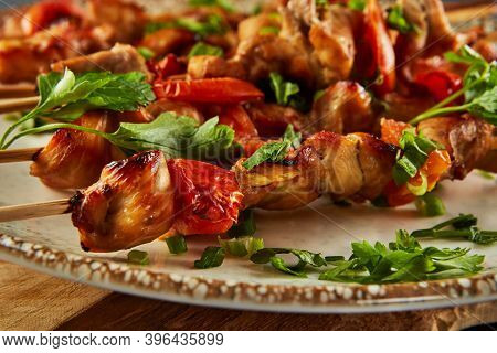 Japanese Style Yakitori Shish Kebab In A Plate On A Wooden Board. Close Up