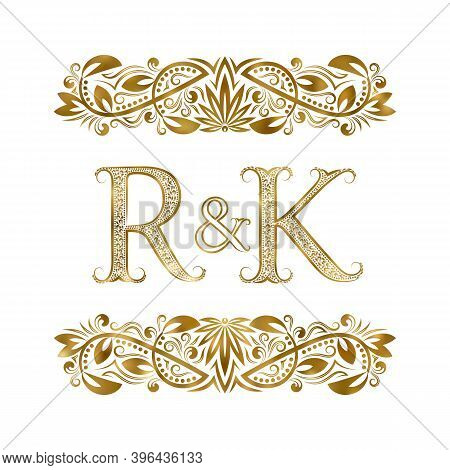 R And K Vintage Initials Logo Symbol. The Letters Are Surrounded By Ornamental Elements. Wedding Or