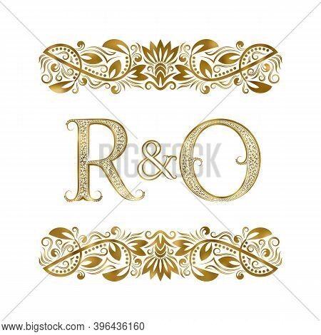 R And O Vintage Initials Logo Symbol. The Letters Are Surrounded By Ornamental Elements. Wedding Or