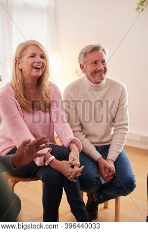 Mature Couple Attending Support Group Meeting For Mental Health Or Dependency Issues