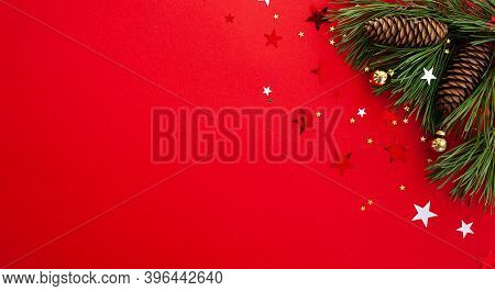 Christmas Background. Christmas Tree Decorated With Sparkling Stars And Balls On A Red Background. F