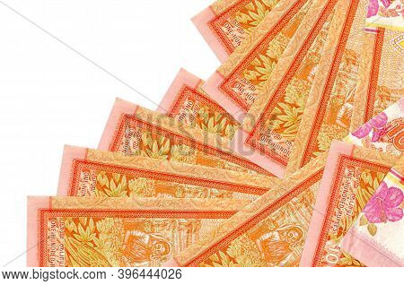 100 Sri Lankan Rupees Bills Lies In Different Order Isolated On White. Local Banking Or Money Making