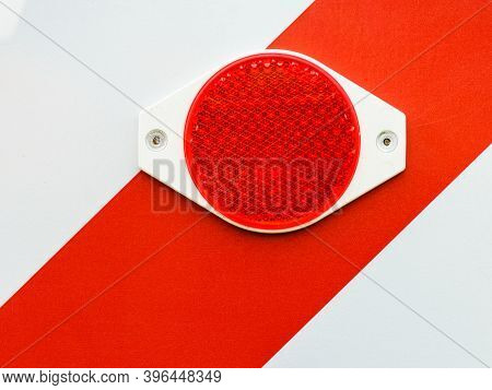 Close Up Of Reflecting Red Elements, Warning Reflectives, Danger Problem White Stripes.
