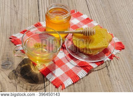 Jar Of Linden Honey, Cup Of Linden Tea And Linden Flowers On Wooden Table On A Sunny Day