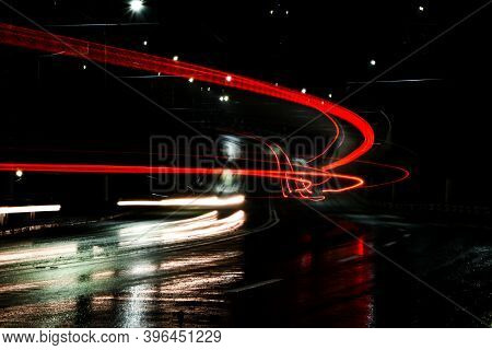 Lights Of Cars At Night. Street Lights. Night City. Long-exposure Photograph Night Road. Wet Road Af
