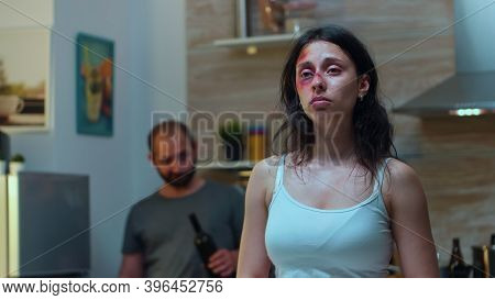 Traumatised Woman Looking At Knife While The Drunk Man Screaming In The Back. Violent Aggressive Hus