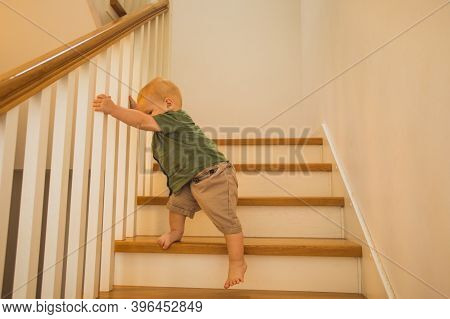 Toddler Boy Is Training New Skills On Stairs
