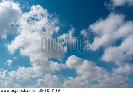 Blue Sky With Clouds Like Cotton. Blue Sky And White Clouds Background. Heavenly Scenery. Meteorolog