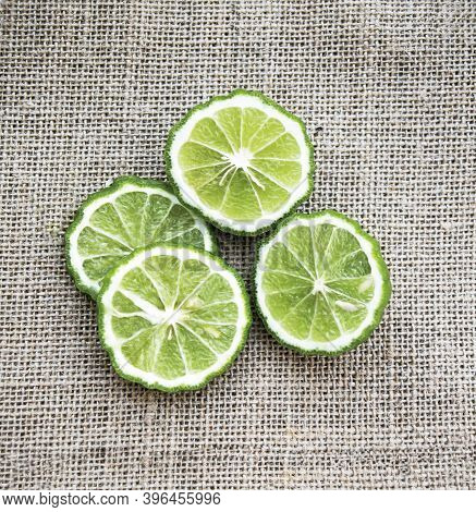 Bergamot Fruit Cutting Slices On Sackcloth Background, It Is Material Of Essential Oils For Beauty A