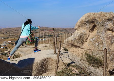 Uchisar, Turkey - October 4, 2020: An Unidentified Young Woman Tries To Capture An Unusual Shot Of T