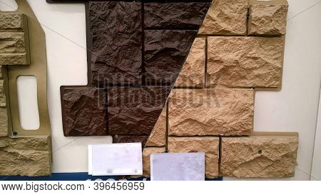 Sample Of Basement Siding With Stone Imitation Dark Brown And Terracotta Color In Store For Sale. Fa
