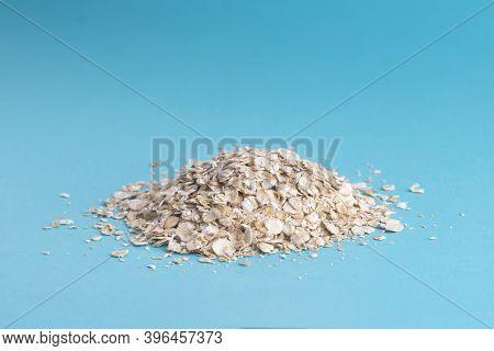 Oatmeal On A Blue Background, A Handful Of Oatmeal.