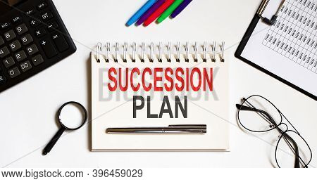 Notebook With Tools And Notes About Succession Plan Business