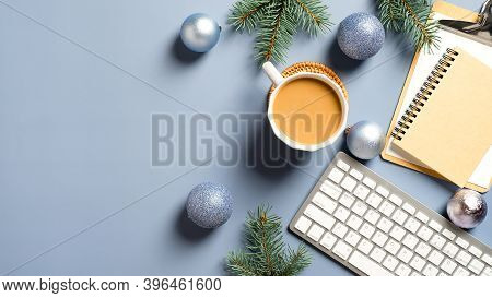 Home Office Table With Christmas Decorations, Coffee Cup, Keyboard, Paper Notebook. Flat Lay, Top Vi