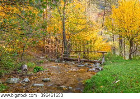 Wooden Bridge Over Stream In A Forest At Autumn. The Mala Fatra National Park, Slovakia, Europe.