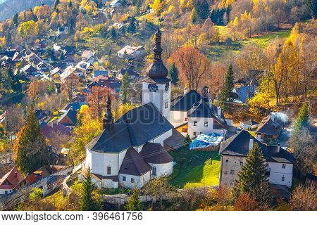 The Spania Dolina Village With Church And Historic Buildings In Valley Of Autumn  Landscape, Slovaki