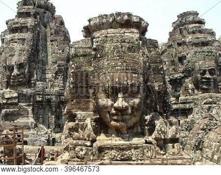 Siem Reap, Cambodia, April 6, 2016: Three Women's Faces Carved Into The Stone At Bayon Temple In The