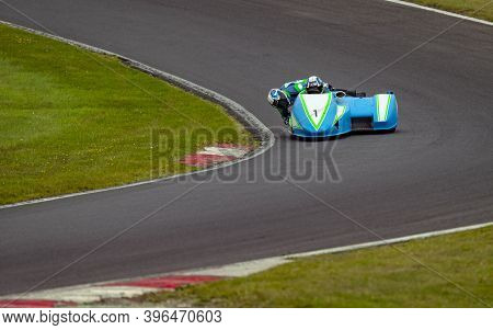 A Shot Of A Racing Sidecar As It Corners On A Track.