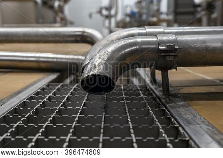 Drain Pipe And Drain Water From Stainless Steel Used In The Food Industry. Floor Drain In The Manufa