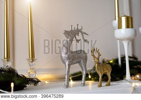 Christmas Deers Are Standing Under A Christmas Tree.