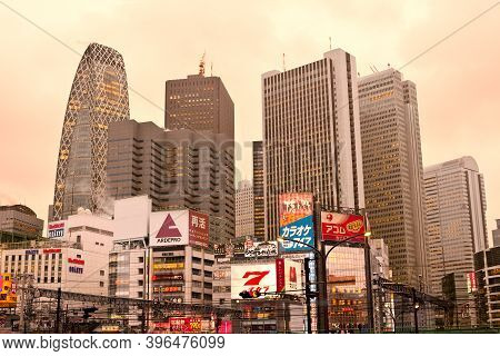 Tokyo, Kanto Region, Honshu, Japan - April 16, 2010: Cityscape Of Buildings And Billboards At Shinju