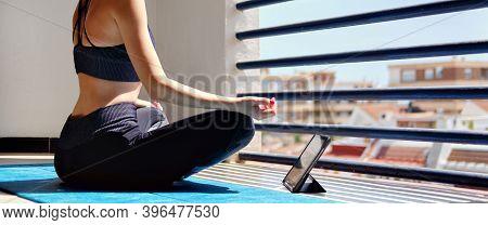 Horizontal View Girl Sit Cross-legged On Mat Do Meditation Practice At Home In Terrace Sunny Warm Da