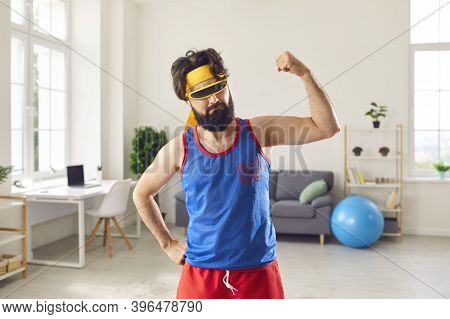 Funny Sportsman Boasting His Thin, Weak Arm Muscles After Sport Workout At Home