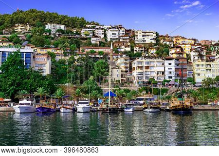 Turkey, Alanya - October 22, 2020: View From The Sea To The Embankment In Alanya Yat Limani. Boats A