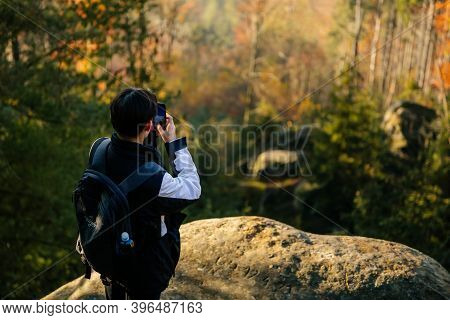Tourist Takes A Photo On His Smartphone, Sandstone Landscape Of Bohemian Paradise, Sunny Day, Rock F