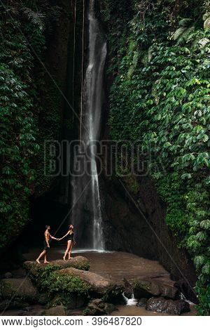 A Couple In Love On A Waterfall. Honeymoon Trip. Happy Couple On The Island Of Bali. Beautiful Coupl