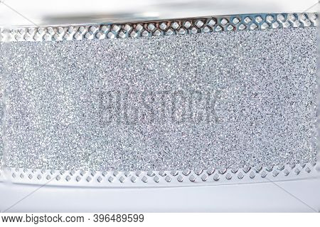 Silver Christmas Wide Ribbon Isolated On White Background. Yellow Glitter Tape With Sparkling Lights