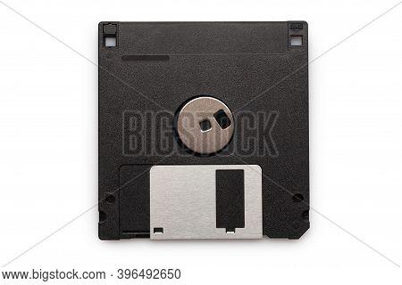 Floppy Disk From Black Plastic Isolated On White Background. Outdated Technology. Data Storage Diske
