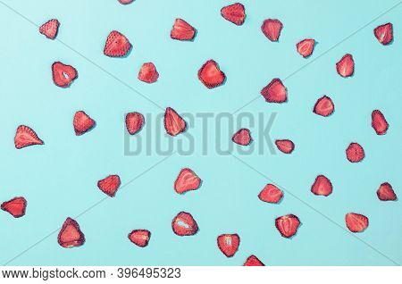 Dried Strawberry Slices Chips Scattered On Blue Background. Fruit Chips. Healthy Eating Concept, Sna