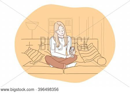 Smartphone, Online Communication, Chatting Concept. Young Girl Sitting At Home With Smartphone In Ha