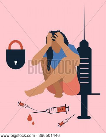 Lonely Drug Addict Woman Sits On The Floor.narcomaniacproblems Concept.lock,giant Syringe, Needle.on