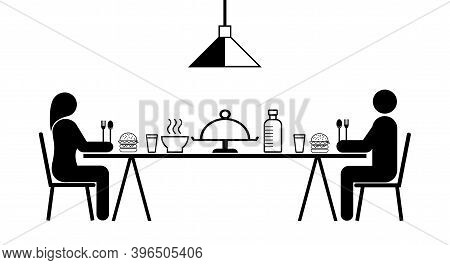 Man And Woman Sitting And Eating Together, Two Meters Apart In The Dining Room, Eating Together In A