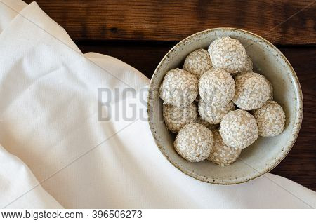 Sesame Sweet Balls Made Of Sesame Flour In Bowl On Linen And Wooden Background. Top View.