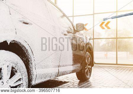 Woman Washing His Car In A Self-service Car Wash Station.car Wash Self-service.