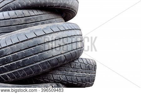 Old Broken Car Tires. Worn Wheel Replacement Concept. On A White Background.