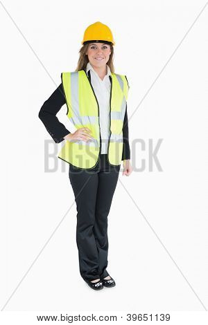Woman in a suit wearing high visibility vest and hard hat