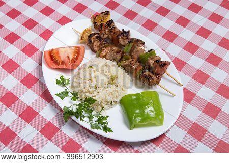 Plate Of Shish Kebab Kuzu Shish With Rice, Tomatoes And Pepper