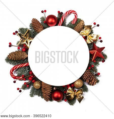 Christmas white blank card with copy space and decor of fir tree branch bauble candy cane pine cone red holly berry isolated on white background