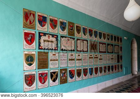 Jerusalem, Israel, November 14, 2020 : The Coats Of Arms Of Famous Hospice Visitors Hang On The Wall