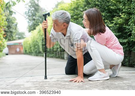 Asian Senior Man Falling Down At Home In The Backyard Caused By Myasthenia (muscle Weakness) And The