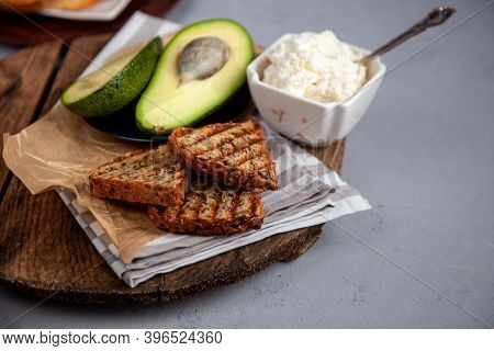 Sandwiches With Soft Cheese, Avocado And Cucumber. Breakfast Is On The Table. Healthy Food. Toast An