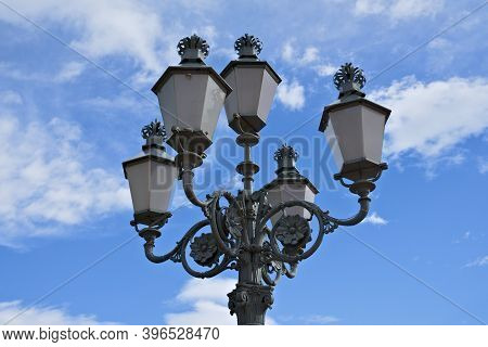 Old Victorian Style Lamppost With Blue Skies And Clouds In The Background